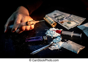 Male junkie hand holding drug syringe, Hard drug addiction