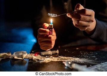 Male Junkie hand preparing heroin dose. Drug addiction concept