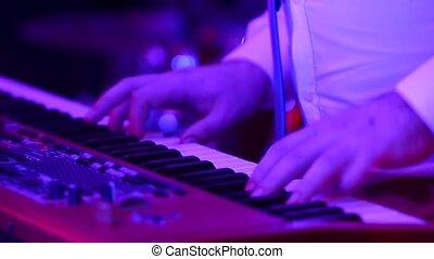 male keyboardist playing keyboard, close-up
