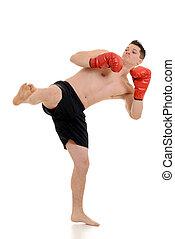 Male kick boxer kicking