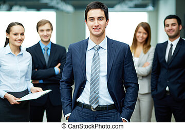 Male leader - Group of friendly businesspeople with male...