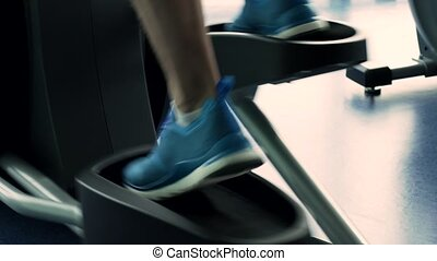 Male Legs During Workout on Elliptical Machine