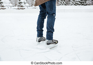 Male legs in ice skates