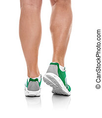 Male legs in sneakers over white.