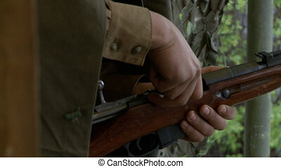 Male loading a rifle with cartridges video - Male in...