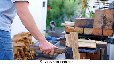 Male lumberjack chopping wooden logs with axe 4k - Mid ...