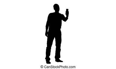 Male makes selfi. White background. Silhouette - Male makes...