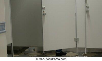 male man runs into the toilet cabin in public wc - guy runs...