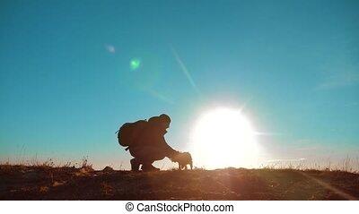 male man traveler raises the little Yorkshire terrier...
