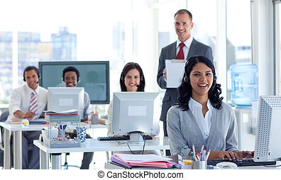 Male manager supervising his team in a call center - Male...