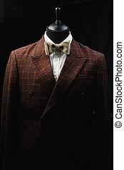 Male Mannequin Formal Wear Fashion Suit Shop Interior, Model on black background