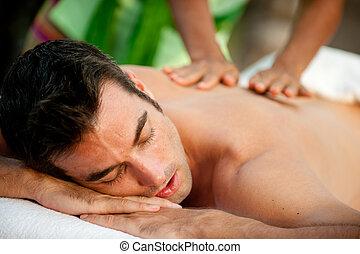 Male Massage - A man getting a massage lying down