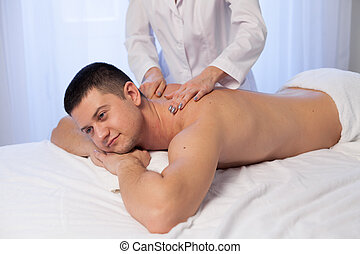 male massage therapist make therapeutic massage and body therapy Spa