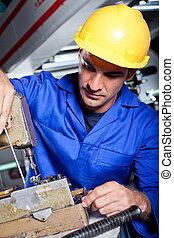male mechanic repairing