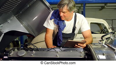 Male mechanic using digital tablet 4k