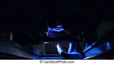 Male mechanic using flaming torch 4k - Male mechanic using ...