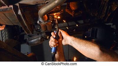 Male mechanic using flaming torch 4k