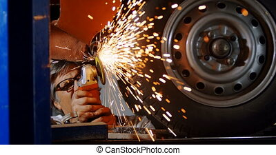 Male mechanic using grinder machine 4k