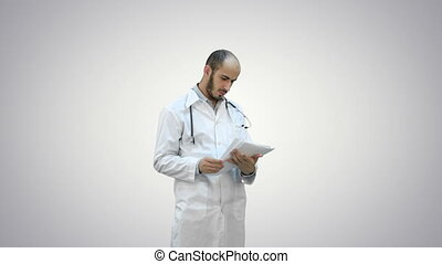 Male medicine doctor checking his papers on white background.