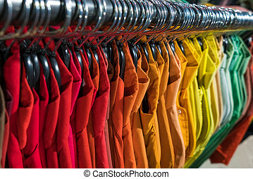 Male Mens Shirts on Hangers in Thrift Shop or Wardrobe Closet Rail
