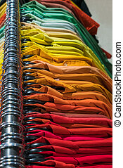 Male Mens Shirts on Hangers on a Shop Wardrobe Closet Rail