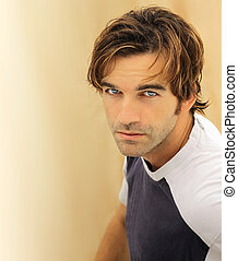 Male model face - Portrait of a casual good looking male...