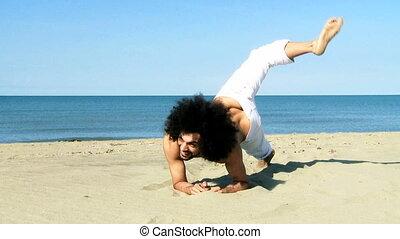 Male model having fun on beach