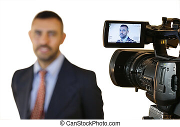 Male model in a photographic studio posing for his portrait with focus to the professional digital camera and open viewfinder in the foreground