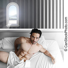Male model in bedroom - Portrait of a handsome male model...