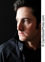 Male model - Attractive brunette male model against black...