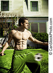 Male model playing soccer