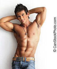Male model shirtless - Portrait of a well built shirtless...