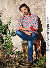 Male model sitting with legs crossed