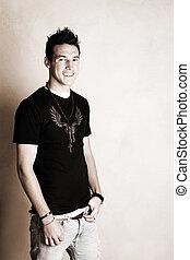 Male Model - Male model in studio against light colored wall