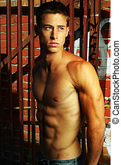 Male model - Sexy shirtless male model in street alley with...