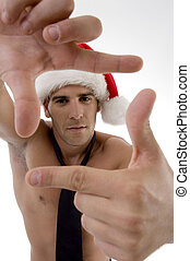 male model wearing christmas hat and framing with hand gesture