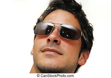Portrait of young trendy male model wearing sunglasses isolated