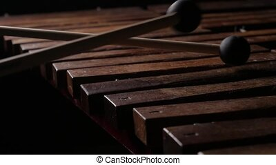 Male musician play xylophone or marimba - Close up of male ...