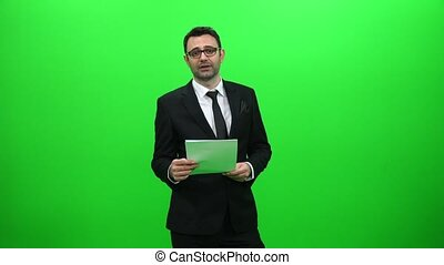 Male News Anchor Presenting on Green Screen