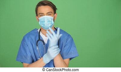 male nurse putting on gloves