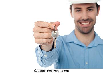 Male offering you office key