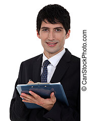 Male office worker with clip-board and pen
