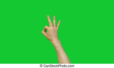 Male ok symbol on green background - Footage of male hands...