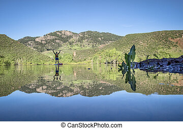male paddler on a stand up paddleboard  in Colorado - low ...