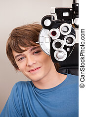 Male Patient Having Eyes Test - Young child having his eyes ...
