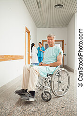 Male patient in a wheelchair in hospital
