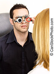 trial frame for eye testing - Male patient on medical...
