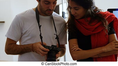 Male photographer and model discussing over photos 4k - Male...