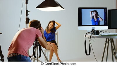 Male photographer clicking photos of model 4k - Male...