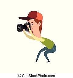 Male photographer with photo camera, paparazzi taking photo,...
